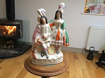 LARGE STAFFORDSHIRE FLATBACK FIGURINE a couple with a dog.in very good condition