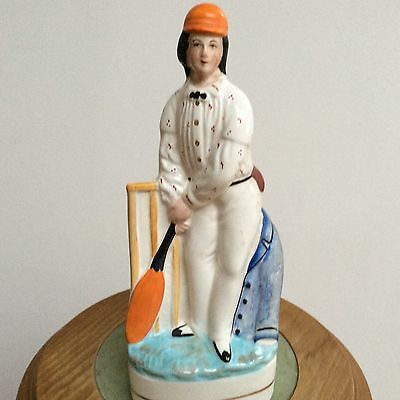 STAFFORDSHIRE ANTIQUE FIGURE OF A CRICKETER in good condition