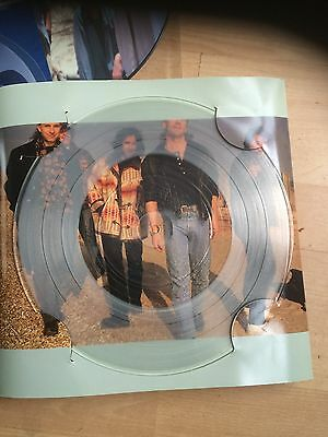 """3 x picture discs and 1 clear vinyl records 12"""" singles"""
