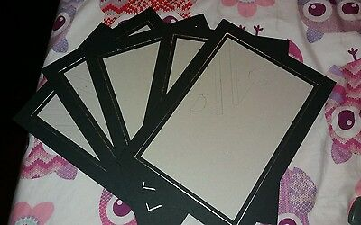 5 x 14x10 inch photo mounts for 11.5x7.5 inch photos. unused. Black with silver
