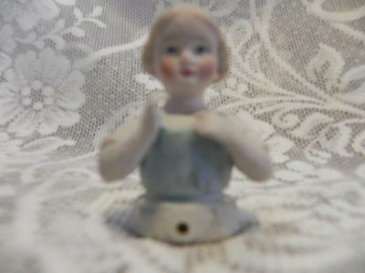 Bisque Half Doll 2 1/4 inches tall.  Little Girl arms away