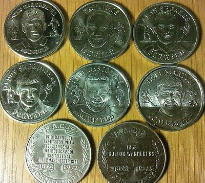 8 football medals/coins
