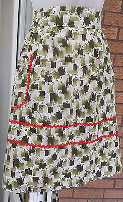 Vintage half apron / pinny classic design green pattern and red trim