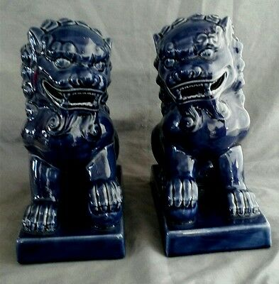 pair foo dogs.cobalt blue 8 12 inches tall