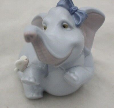 NAO LlADRO BABY ELEPHANT WITH BUTTERFLY  Don't tell anybody by Paul Rubio -214