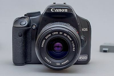 Canon EOS 450D 12,2 Mp DSLR with 38-76mm lens, charger, 3 batteries and a strap