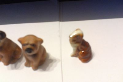 A Complete Set Of Four Lovely Ceramic Puppy Miniatures Just 4Cm High