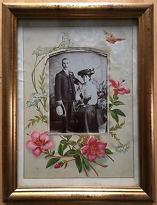 Photograph of an Edwardian couple in original album page mount, framed