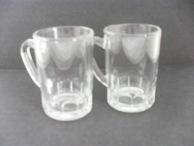 A pair of minature glass tankards