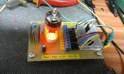 Valve Amp Prototyping board Electronics with Breadboard and various Capacitors.