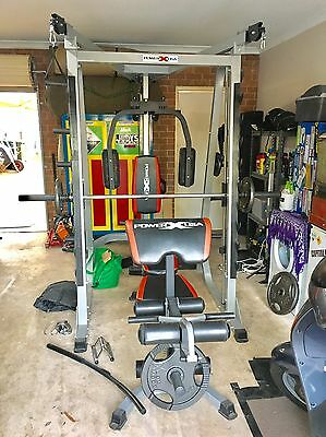 POWER X USA Smith Machine with cable cross overs, bench and weights.