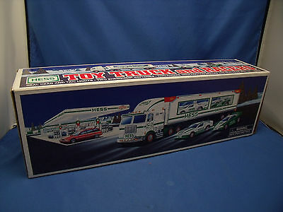 """Hess """"Hess Toy Truck and Racers"""" 1997 Head and Tail Lights 18 Wheeler 2 Racers O"""