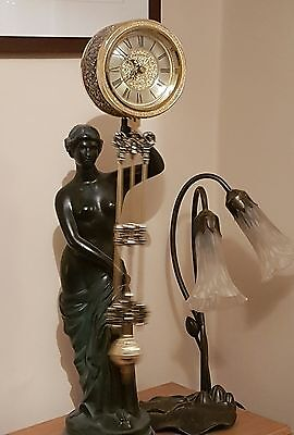 Lady statue with clock