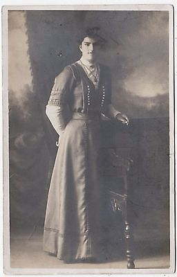 A STANDING LADY - by Walker - c1910s era Lincoln Real Photo postcard