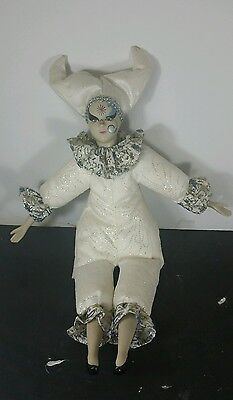Porcelain painted face doll with white fancy cloths