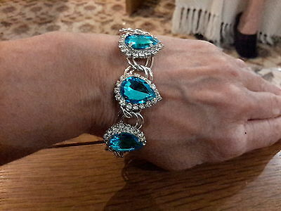 Brand new silver  bracelet  with large blue topaz look stones and  gift box