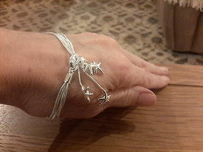 Brand new 925 stamped silver bracelet with stars and gift box