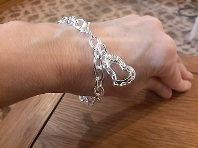 Brand new  925 stamped hollow punched out heart bracelet with gift box