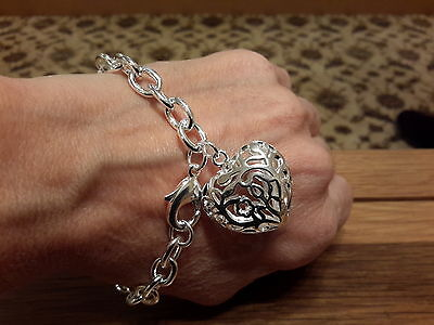 Brand new  Silver plated chunky Bracelet with a large heart charm