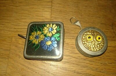 Two vintage sewing tape measures