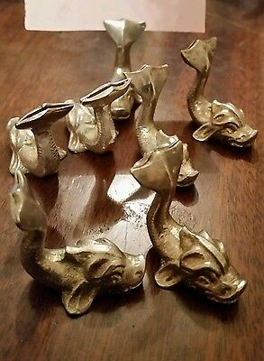 8 white metal Dolphin menu holders, place markers