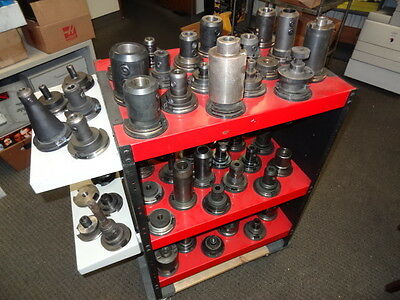 Lot Of 60 Pieces CAT 50 Tool Holders and 64 tool holder rack, endmill, facemill
