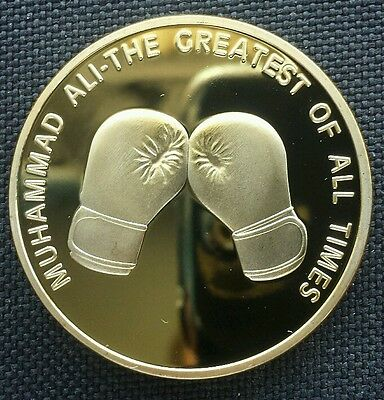Commemorative Gold Plated Coin.. Muhammad Ali.. Obverse side shows.. A Portrai