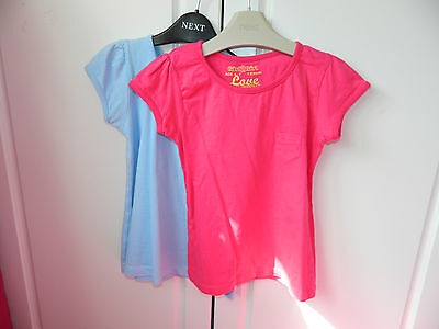Pack of 2  short sleeved T-Shirts. Age 6-7 years