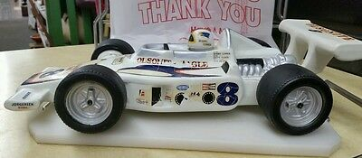 Racing car Decanter features Bobby Unser Ozzie Olson Wayne Leary