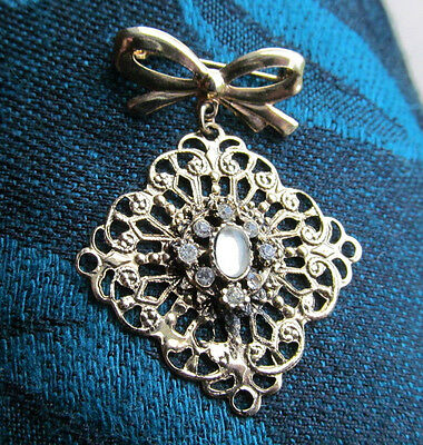 Filigree gold tone dangle brooch pin Bow and Rhinestones