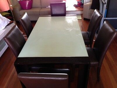 Dining table and leather chairs