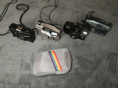 Lot of Cameras 35 mm point shoot mixed lot as is untested rainbow bag