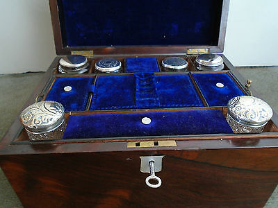 A  Victorian Rosewood &  Mother of Pearl inset Vanity Box with fitted Interior .