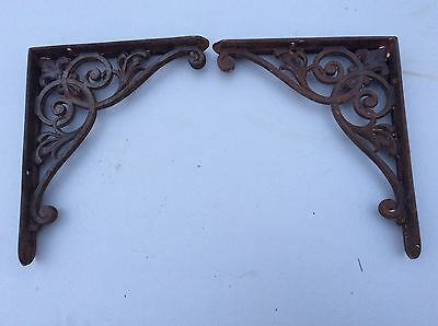 A pair of Victorian scrolled cast iron brackets  wall shelf bracket