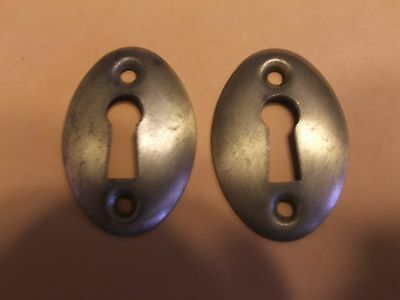 Two Vintage Key Escutcheons