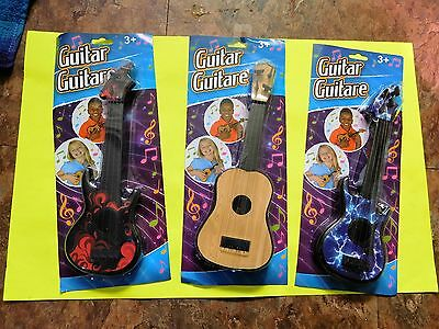 toy guitars 4 string lot of 3 different ones 12.00 free shipping
