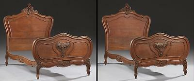 Pair of French Carved Walnut Louis XV Style Beds, early 1900s