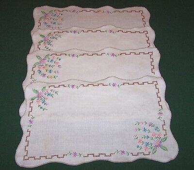 4 VINTAGE LINEN PLACEMATS, HAND EMBROIDERED FLORAL MOTIF, c1940