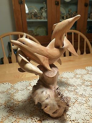 Wooden Carved Dolphins - 3 handcarved on natural wooden base resembling coral