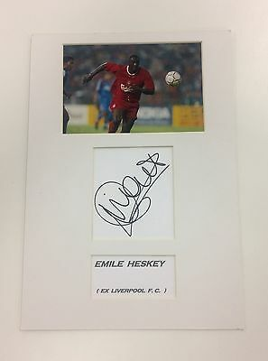 A 29 x 21 cm mounted display personally signed by Emile Heskey of Liverpool.