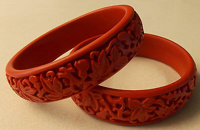 Vintage Pair of Chinese Cinnabar Deeply Carved Floral Bangle Bracelets