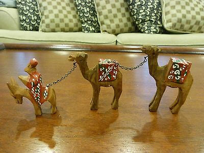 Vintage Hand Carved Wooden Camel Team Figurines 2 Camels with leader on a donkey