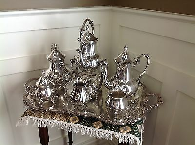 Sheridan Silverplate Coffee & Tea Set with additional urn and heating stand.