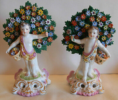 PAIR OF 19th CEN. CHELSEA GOLD ANCHOR PORCELAIN FIGURINES, PUTTIES WITH FLOWERS