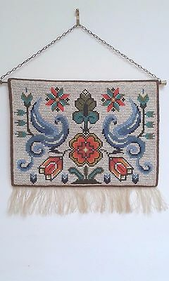 Swedish embroidered wool wall hanging with a blue birds