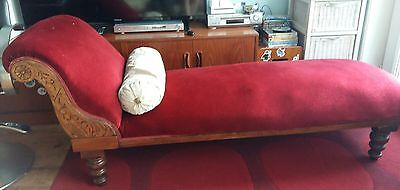 Antique chaise longue, pretty carved side, red upholstery