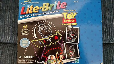 12 Toy Story AND 14 Pictured Lite Brite sheets (unused)