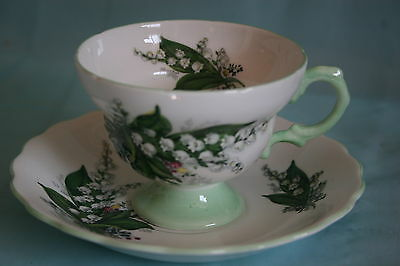 Lovely Vint Rosina china footed tea cup saucer- Lily of the Valley, green handle