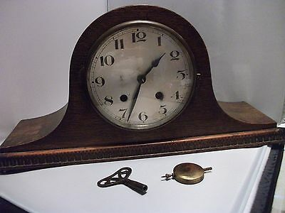 antique Napoleon  hat style mantel clock with pendulum and key good codition