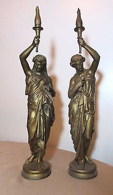 pair antique bronze patinated gilded lady with carrying torch figural statue